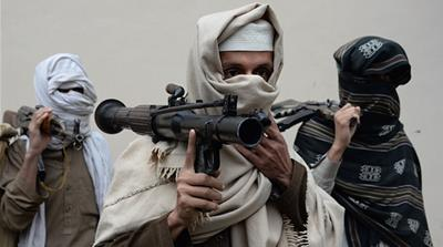 Former Afghan Taliban fighters hand over their weapons as part of a government reconciliation process in Nangarhar province [AFP]