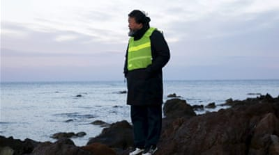 Chinese artist Ai Weiwei stands at a beach where refugees and migrants arrive daily on the Greek island of Lesbos [REUTERS]