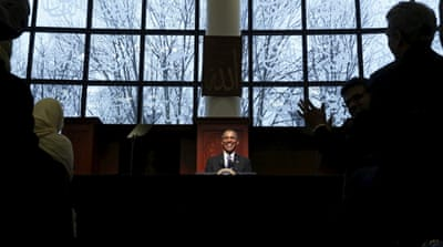Secret Service agents stand watch nearby as Obama delivers remarks at the Islamic Society of Baltimore mosque [Reuters]