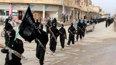 ISIL fighters parade along the streets in Syria's Raqqa province in June 2014 [Reuters]