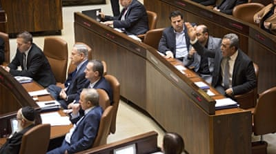 Israeli Justice Minister Ayelet Shaked (centre) introduced the NGO bill [Abir Sultan/EPA]