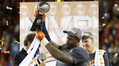 Keo (33), Smith (90) and Harris (25) celebrate Broncos' first Super Bowl win in 17 years [Matthew Emmons-USA TODAY Sports]