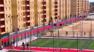 The rolling out of the carpet on paved roads has been dubbed as lavish and wasteful [Egyptian TV]