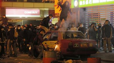 Rioters thew bricks at police in Mong Kok district of Hong Kong [Vincent Yu/AP]