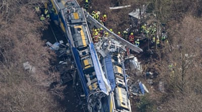The trains collided head-on on a single stretch of line linking Bavaria with Austria [Michael Dalder/Reuters]