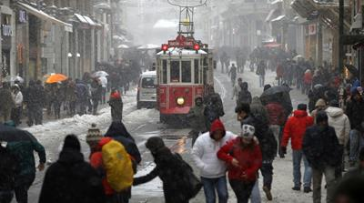 People walk in Istanbul's busy Istiklal Street [AP]