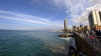 People fish at the coastline of al-Manara during a sunny day in Beirut, Lebanon [EPA]
