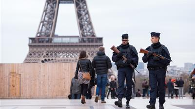 Policemen patrol Paris a day after the November 13 attacks. We investigate whether France's new counterterrorism measures undermine the very liberties the French Republic is so eager to protect [EPA]