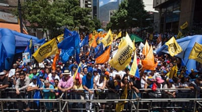 "Thousands attended both the opposition's rally and the ruling Socialists' ""anti-Imperialist"" march in Venezuela [EPA]"