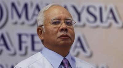 Najib Razak's government has been accused of rolling back media freedoms [AP/File]