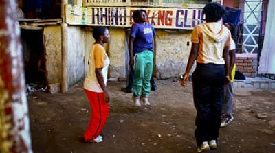 The boxers warm up at their ramshackle Katanga slum training club, although they lack boxing basics like gloves, belts, boots and even water [Edward Echwalu/Al Jazeera]