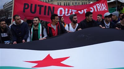 From the square, the crowd marched in columns to the nearby Russian embassy [Sorin Furcoi/Al Jazeera]