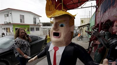Donald Trump and Batman pinatas in a shop in Mexico City [Tim MacGabhann/Al Jazeera]