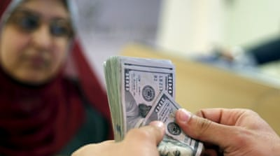 Egypt's currency devaluation fuels debate