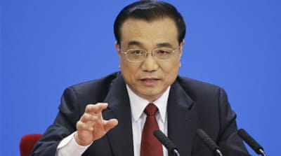 China's Li promises reform as growth slows