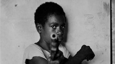 Guns and arrows: Portraits from Papua New Guinea