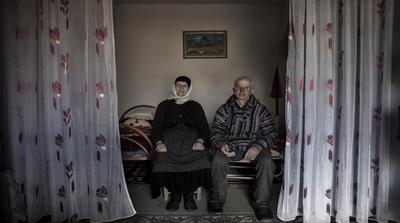 Seventy-year-old Kol Shllaku sits in his prison cell in Kruje. He has already served nine years and must serve another 13 for participating in a blood feud [Carlo Gianferro/Al Jazeera]