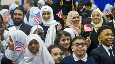 Children react after seeing US President Barack Obama during his visit to the Islamic Society of Baltimore [AP]