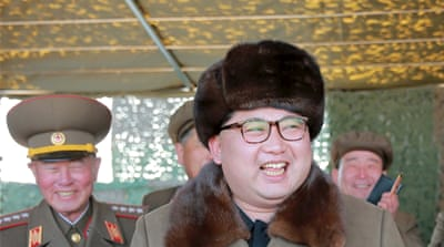 Kim Jong-un attends a recent demonstration of a new multiple rocket launching system [Reuters]