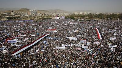 Supporters of the former president Ali Abdullah Saleh attend a rally marking one year of the war [Hani Mohammed/AP]