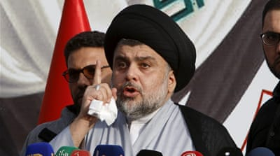 Muqtada al-Sadr speaks during a sit-in at the gates of the Green Zone on Sunday [Khalid al-Mousily/Reuters]