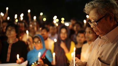 The father of the writer-blogger Avijit Roy attends a candlelight vigil at the spot where his son was killed in Dhaka, Bangladesh [EPA]