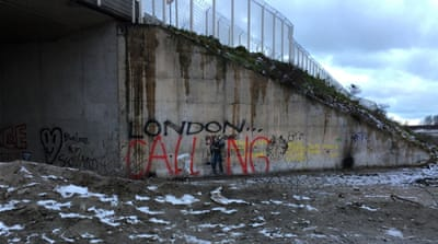 Graffiti welcoming those entering the Calais 'Jungle' [Al Jazeera]