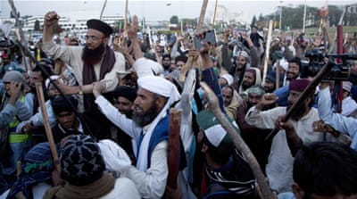 Qadri was convicted for murder and hanged, resulting in periodic protests by his supporters [Faisal Mahmood/Reuters]