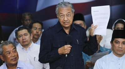 Former Prime Minister Mahathir Mohamad is leading calls for Prime Minister Najib Razak to be removed from office [EPA]