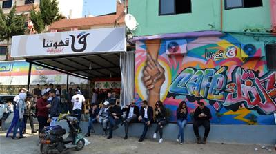 Last week's grand opening of the cafe on Tripoli's Syria Street was attended by a capacity crowd [India Stoughton/Al Jazeera]