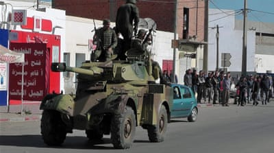 Tunisia closes border with Libya after fierce clashes