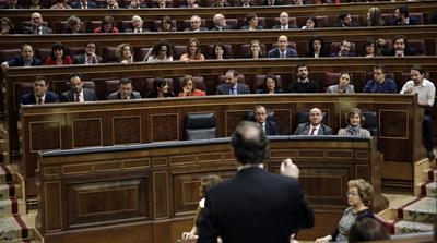 Mariano Rajoy addresses deputies during an investiture debate at parliament in Madrid, Spain [REUTERS]