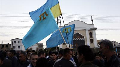 Crimean Tatars mark the 70th anniversary of the deportation of Tatars from Crimea, near a Mosque in Simferopol in 2014 [Getty]