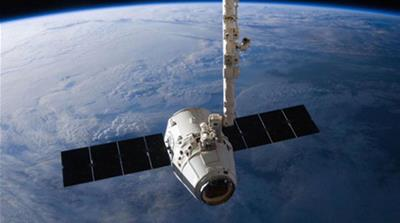 The SpaceX Dragon cargo capsule approaches the International Space Station prior to installation in this NASA picture taken April 10, 2016. REUTERS/NASA via  [Reuters]