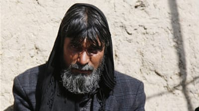 Asadullah, 40, who lost his wife and children in a Taliban raid on their home, can't afford to pay a smuggler to leave Afghanistan [Jawad Jalali/Al Jazeera]
