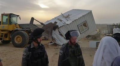 Within minutes, 35 Palestinians became homeless as Israeli bulldozers demolished their metal homes in the West Bank village of Umm al-Khair [Tariq and Eid Hathaleen/Al Jazeera]