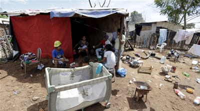 A Paraguayan woman cooks in one of Paraguay's poorest neighborhoods in Asuncion. [Reuters]