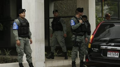 Organised crime police outside Mossack Fonseca's headquarters in Panama City on Tuesday as the offices were being searched [AP]