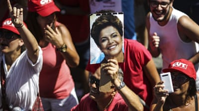Government supporters take part in a pro-Rousseff demonstration in Rio de Janeiro on Sunday [EPA]