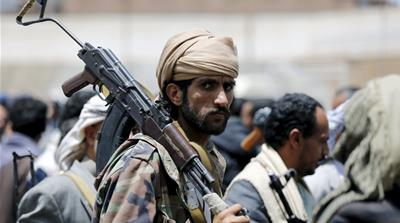 A tribesman loyal to the Houthi movement carries his rifle as he attends a gathering in Yemen''s capital Sanaa [REUTERS]