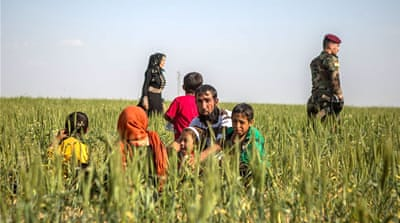 Families flee ISIL in Iraq