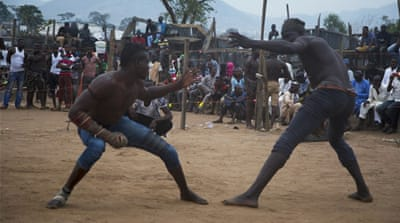 Boxer, Shagon Dan Kanawa, whose real name is Mohammed Izazuddin Hassan, stares at his opponent [Chika Oduah/Al Jazeera]