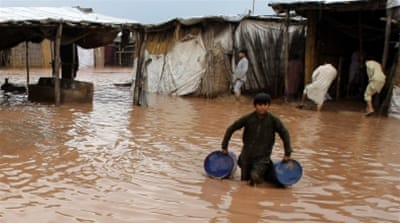 Homes in the Khyber Pakhtunkhwa province faced extensive damage in the wake of the flash floods [Arshad Arbab/EPA]