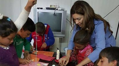 Hivron Turanli during a Paint Away the Trauma workshop in northern Iraq [Al Jazeera]