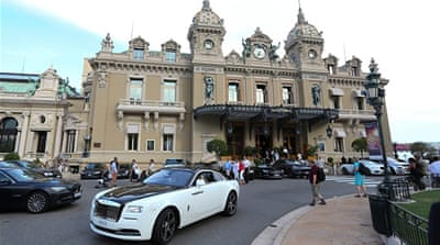 A Rolls-Royce drives in front of the Casino de Monte-Carlo in Monaco [Getty]