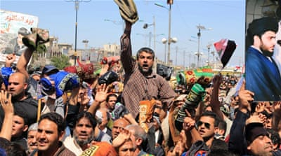 Followers of Iraq's influential Shia cleric Muqtada al-Sadr call for governmental reforms during a protest in Baghdad, Iraq [AP]