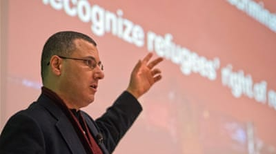 Omar Barghouti accused Israeli authorities of imposing a travel ban on him as retribution for his political activities [AFP/FILE]