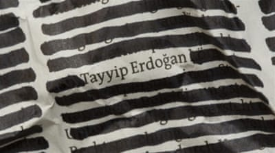 A censored newspaper article with the readable name Tayyip Erdogan in Bonn, Germany [Getty Images]
