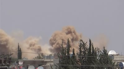 Screenshot taken from Youtube of Khan Eshieh being hit by barrel bombs [File: Al Jazeera]