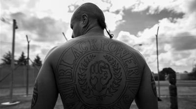 A Maori inmate's back is decorated with a tattoo representing New Zealand gang, Black Power [Aaron Smale/IKON Media]